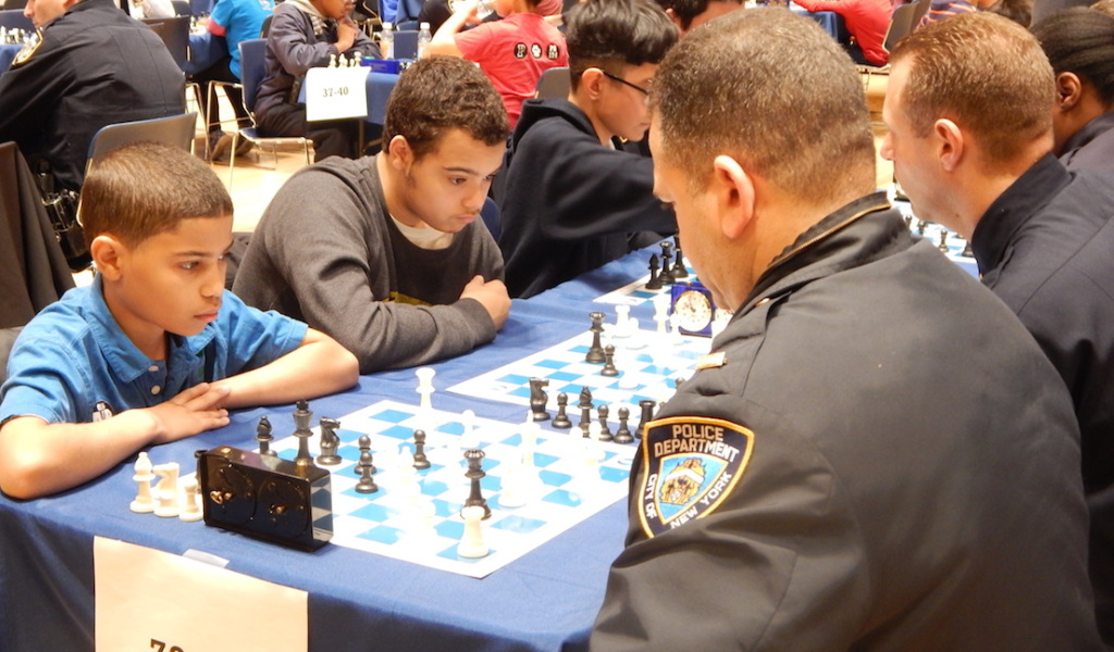 "The ""Chess in the Schools"" program has taught critical thinking skills to NYC's public school students through the game since 1986. This is the first year the program partnered with the NYPD."